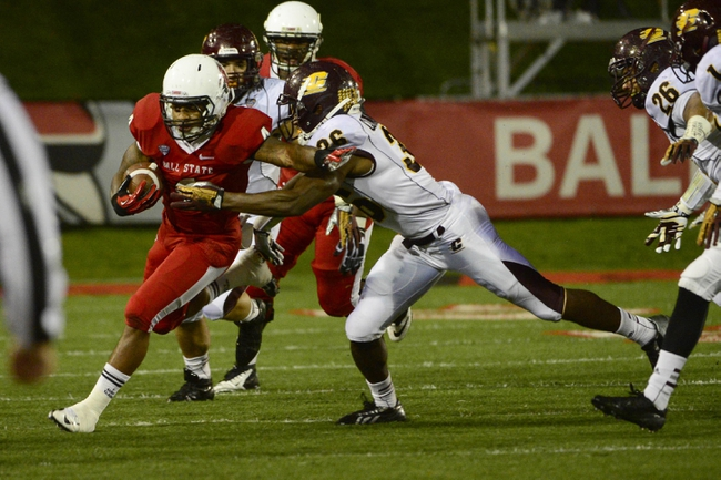 Nov 6, 2013; Muncie, IN, USA; Ball State Cardinals running back Horactio Banks (4) is tackled by  Central Michigan Chippewas defensive back Avery Cunningham (36) at Scheumann  Stadium. Mandatory Credit: Marc Lebryk-USA TODAY Sports