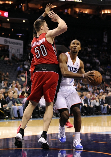 Nov 6, 2013; Charlotte, NC, USA; Charlotte Bobcats guard Ramon Sessions (7) looks to shoot as he is defended by Toronto Raptors forward Tyler Hansbrough (50) during the game at Time Warner Cable Arena. Bobcats win 92-90. Mandatory Credit: Sam Sharpe-USA TODAY Sports