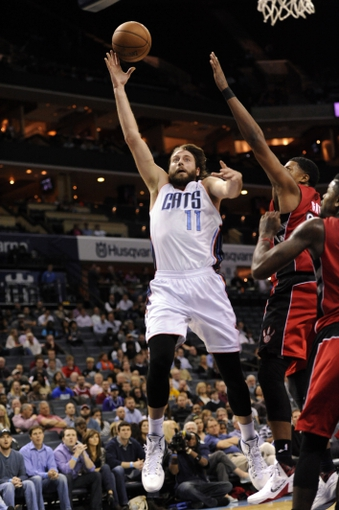 Nov 6, 2013; Charlotte, NC, USA; Charlotte Bobcats forward Josh McRoberts (11) drives to the basket during the game against the Toronto Raptors at Time Warner Cable Arena. Bobcats win 92-90. Mandatory Credit: Sam Sharpe-USA TODAY Sports