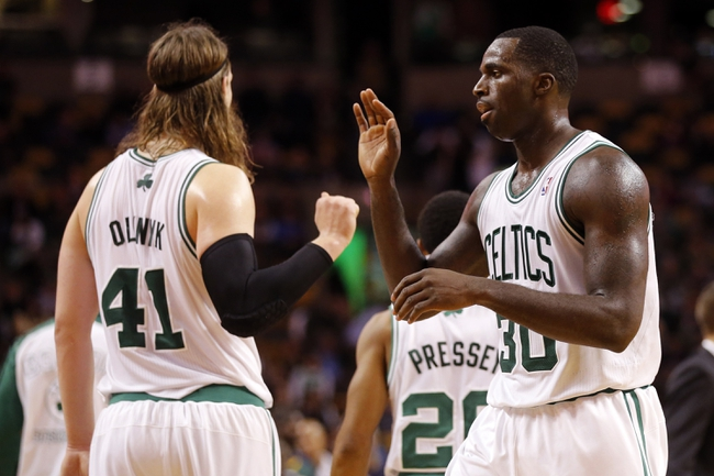 Nov 6, 2013; Boston, MA, USA; Boston Celtics power forward Brandon Bass (30) reacts with power forward Kelly Olynyk (41) after a play against the Utah Jazz in the second half at TD Garden. The Celtics defeated the Jazz 97-87. Mandatory Credit: David Butler II-USA TODAY Sports