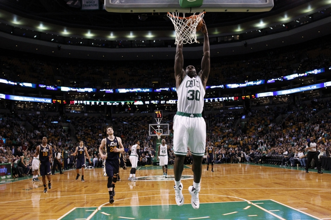 Nov 6, 2013; Boston, MA, USA; Boston Celtics power forward Brandon Bass (30) takes the ball to the basket against Utah Jazz small forward Gordon Hayward (20) in the second half at TD Garden. The Celtics defeated the Jazz 97-87. Mandatory Credit: David Butler II-USA TODAY Sports