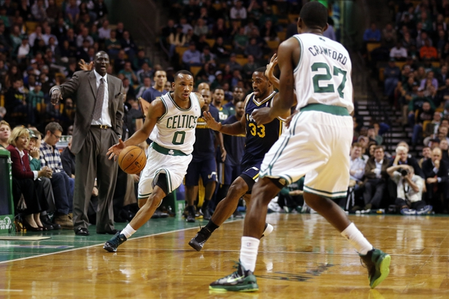 Nov 6, 2013; Boston, MA, USA; Boston Celtics point guard Avery Bradley (0) drives the ball against Utah Jazz small forward Mike Harris (33) in the second half at TD Garden. The Celtics defeated the Jazz 97-87. Mandatory Credit: David Butler II-USA TODAY Sports