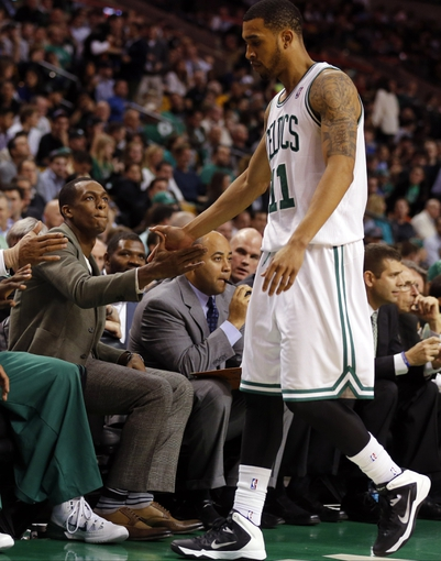 Nov 6, 2013; Boston, MA, USA; Boston Celtics point guard Rajon Rondo (left) greets shooting guard Courtney Lee (11) after play against the Utah Jazz in the second half at TD Garden. The Celtics defeated the Jazz 97-87. Mandatory Credit: David Butler II-USA TODAY Sports