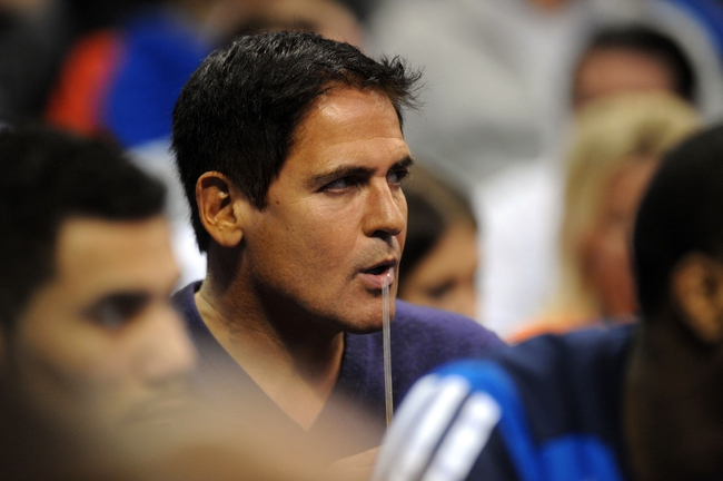 Nov 6, 2013; Oklahoma City, OK, USA; Dallas Mavericks owner and television entertainer Marc Cuban takes a drink while watching action against the Oklahoma City Thunder during the second quarter at Chesapeake Energy Arena. Mandatory Credit: Mark D. Smith-USA TODAY Sports