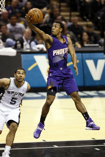 Nov 6, 2013; San Antonio, TX, USA; Phoenix Suns guard Ish Smith (3) drives to the basket as San Antonio Spurs guard Cory Joseph (5) looks on during the second half at AT&T Center. The Spurs won 99-96. Mandatory Credit: Soobum Im-USA TODAY Sports