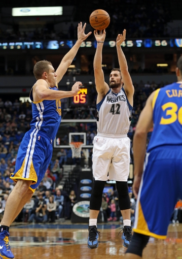 Nov 6, 2013; Minneapolis, MN, USA; Minnesota Timberwolves power forward Kevin Love (42) goes up for a shot over Golden State Warriors power forward David Lee (10) in the second half at Target Center. The Warriors won 106-93. Mandatory Credit: Jesse Johnson-USA TODAY Sports