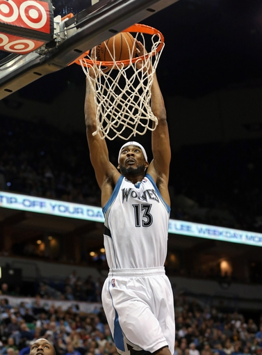 Nov 6, 2013; Minneapolis, MN, USA; Minnesota Timberwolves small forward Corey Brewer (13) dunks the ball in the second half against the Golden State Warriors at Target Center. The Warriors won 106-93. Mandatory Credit: Jesse Johnson-USA TODAY Sports