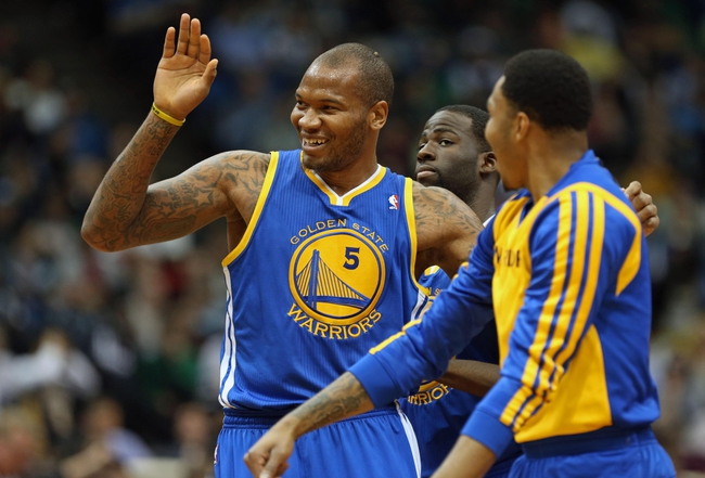 Nov 6, 2013; Minneapolis, MN, USA; Golden State Warriors power forward Marreese Speights (5) celebrates after making a buzzer beating shot in the third quarter against the Minnesota Timberwolves at Target Center. The Warriors won 106-93. Mandatory Credit: Jesse Johnson-USA TODAY Sports