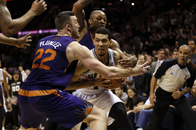 Nov 6, 2013; San Antonio, TX, USA; San Antonio Spurs guard Danny Green (4) gets pressure from Phoenix Suns forward Miles Plumlee (left) and P.J Tucker (behind) during the second half at AT&T Center. The Spurs won 99-96. Mandatory Credit: Soobum Im-USA TODAY Sports