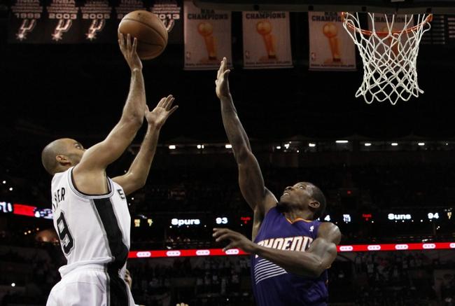 Nov 6, 2013; San Antonio, TX, USA; San Antonio Spurs guard Tony Parker (9) takes a shot over Phoenix Suns guard Eric Bledsoe (2) during the second half at AT&T Center. The Spurs won 99-96. Mandatory Credit: Soobum Im-USA TODAY Sports