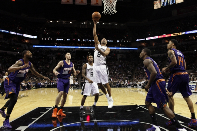 Nov 6, 2013; San Antonio, TX, USA; San Antonio Spurs guard Tony Parker (9) shoots during the second half against the Phoenix Suns at AT&T Center. The Spurs won 99-96. Mandatory Credit: Soobum Im-USA TODAY Sports