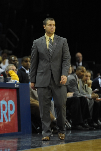 Nov 6, 2013; Memphis, TN, USA; Memphis Grizzlies head coach David Joerger reacts to a play against New Orleans Pelicans during the second half at FedExForum. New Orleans Pelicans defeat the Memphis Grizzlies 99-84. Mandatory Credit: Justin Ford-USA TODAY Sports