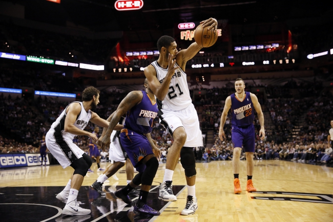 Nov 6, 2013; San Antonio, TX, USA; San Antonio Spurs forward Tim Duncan (21) grabs a rebound in front of Phoenix Suns forward P.J Tucker (17) during the second half at AT&T Center. The Spurs won 99-96. Mandatory Credit: Soobum Im-USA TODAY Sports