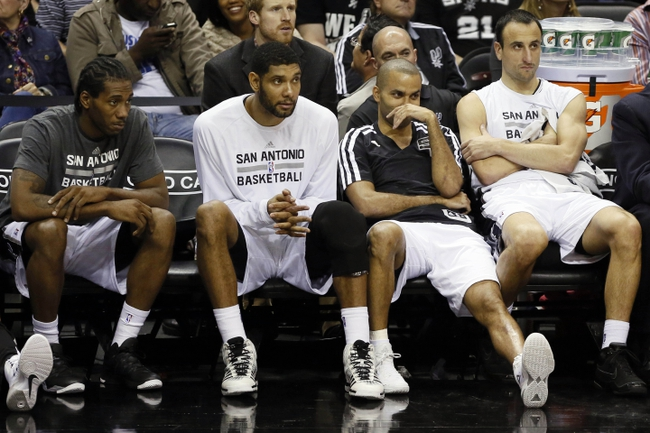 Nov 6, 2013; San Antonio, TX, USA; San Antonio Spurs players (from left) Kawhi Leonard, and Tim Duncan, and Tony Parker, and Manu Ginobili watch from the bench during the first half against the Phoenix Suns at AT&T Center. Mandatory Credit: Soobum Im-USA TODAY Sports
