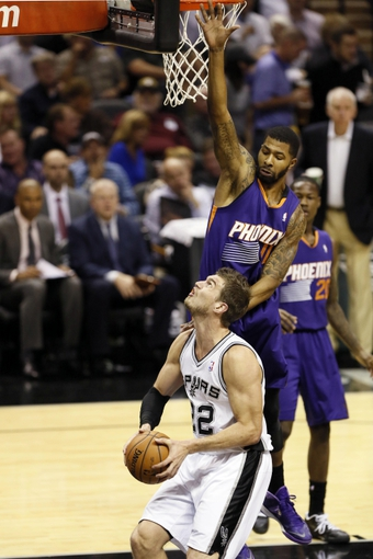 Nov 6, 2013; San Antonio, TX, USA; San Antonio Spurs forward Tiago Splitter (22) looks to shoot as he is defended by Phoenix Suns forward Markieff Morris (11) during the first half at AT&T Center. Mandatory Credit: Soobum Im-USA TODAY Sports