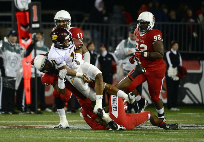 Nov 6, 2013; Muncie, IN, USA; A group of Ball State Cardinals tackle Central Michigan Chippewas running back Maurice Shoemaker-Gilmore (11) during the second half of the game  at Scheumann  Stadium. The Ball Sate Cardinals beat Central Michigan Chippewas 44 to 24. Mandatory Credit: Marc Lebryk-USA TODAY Sports