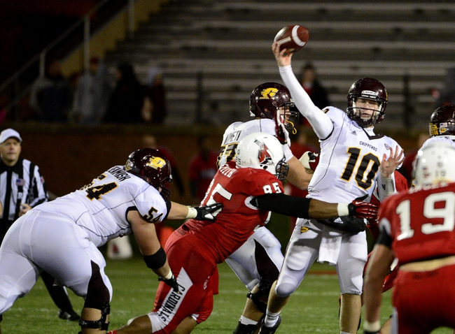 Nov 6, 2013; Muncie, IN, USA;  Central Michigan Chippewas quarterback Cooper Rush (10) throws the ball to avoid being sacked by Ball State Cardinals defensive tackle Darnell Smith (95) in the first half of the game at Scheumann  Stadium. The Ball Sate Cardinals beat Central Michigan Chippewas 44 to 24. Mandatory Credit: Marc Lebryk-USA TODAY Sports