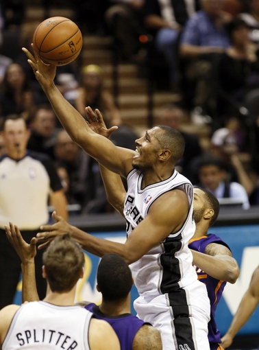 Nov 6, 2013; San Antonio, TX, USA; San Antonio Spurs forward Boris Diaw (33) drives to the basket against the Phoenix Suns during the first half at AT&T Center. Mandatory Credit: Soobum Im-USA TODAY Sports