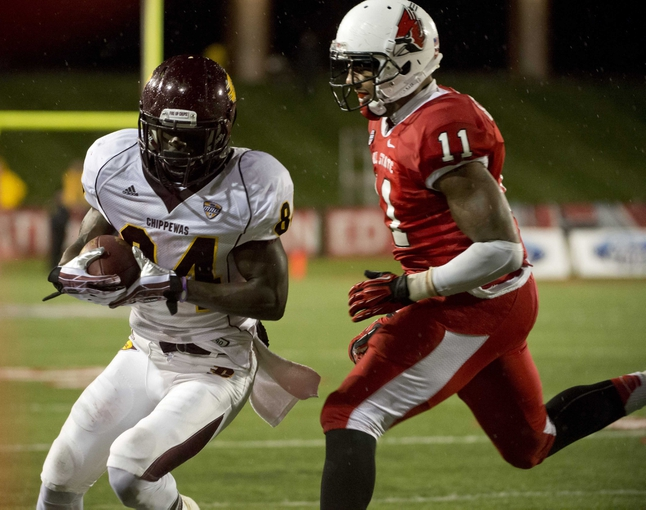 Nov 6, 2013; Muncie, IN, USA;  Central Michigan Chippewas wide receiver Titus Davis (84) runs against Ball State Cardinals defensive end Jonathan Newsome (11) in the first half of the game at Scheumann  Stadium. The Ball Sate Cardinals beat Central The Michigan Chippewas 44 to 24Mandatory Credit: Marc Lebryk-USA TODAY Sports