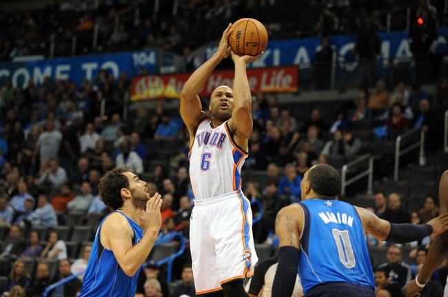Nov 6, 2013; Oklahoma City, OK, USA; Oklahoma City Thunder point guard Derek Fisher (6) attempts a shot against Dallas Mavericks small forward Shawn Marion (0) and Mavericks point guard Jose Calderon (8) during the third quarter at Chesapeake Energy Arena. Mandatory Credit: Mark D. Smith-USA TODAY Sports