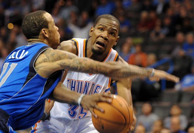 Nov 6, 2013; Oklahoma City, OK, USA; Oklahoma City Thunder small forward Kevin Durant (35) handles the ball against Dallas Mavericks shooting guard Monta Ellis (11) during the fourth quarter at Chesapeake Energy Arena. Mandatory Credit: Mark D. Smith-USA TODAY Sports
