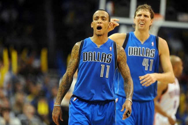 Nov 6, 2013; Oklahoma City, OK, USA; Dallas Mavericks shooting guard Monta Ellis (11) and power forward Dirk Nowitzki (41) react to a call in action against the Oklahoma City Thunder during the fourth quarter at Chesapeake Energy Arena. Mandatory Credit: Mark D. Smith-USA TODAY Sports