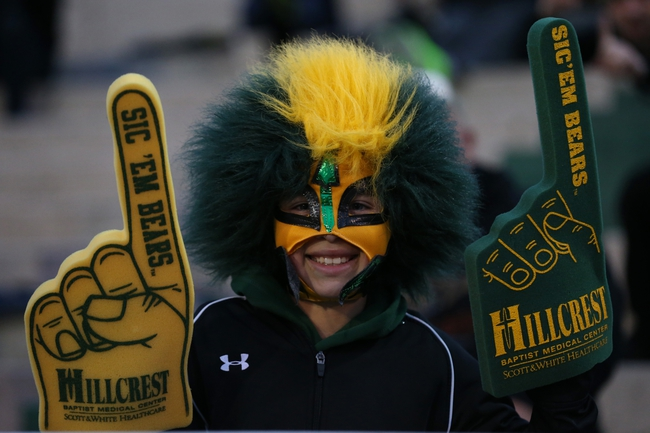 Nov 7, 2013; Waco, TX, USA; Baylor Bears fan Dylan Ceniceros (age 9) poses for a photo prior to the game against the Oklahoma Sooners at Floyd Casey Stadium. Mandatory Credit: Matthew Emmons-USA TODAY Sports