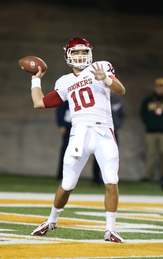 Nov 7, 2013; Waco, TX, USA; Oklahoma Sooners quarterback Blake Bell (10) throws prior to the game against the Baylor Bears at Floyd Casey Stadium. Mandatory Credit: Matthew Emmons-USA TODAY Sports