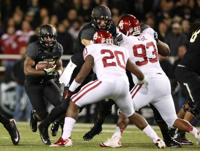 Nov 7, 2013; Waco, TX, USA; Baylor Bears running back Lache Seastrunk (25) runs with the ball against the Oklahoma Sooners at Floyd Casey Stadium. Mandatory Credit: Matthew Emmons-USA TODAY Sports