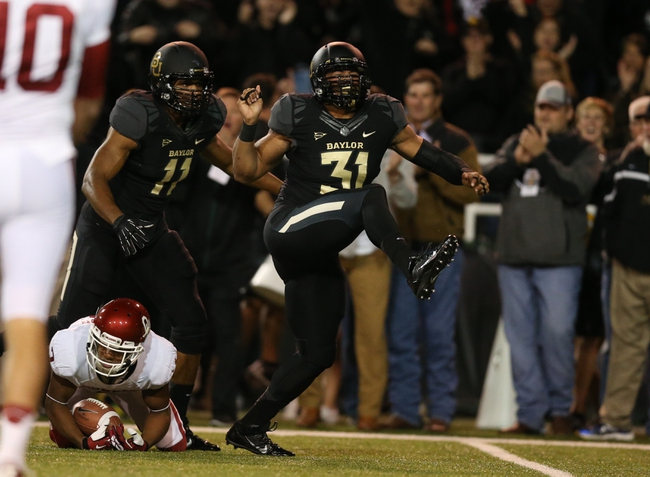 Nov 7, 2013; Waco, TX, USA; Baylor Bears defensive end Chris McAllister (31) celebrates a tackle for a loss on a reverse in the first quarter against Oklahoma Sooners receiver Sterling Shepard (3) at Floyd Casey Stadium. Mandatory Credit: Matthew Emmons-USA TODAY Sports