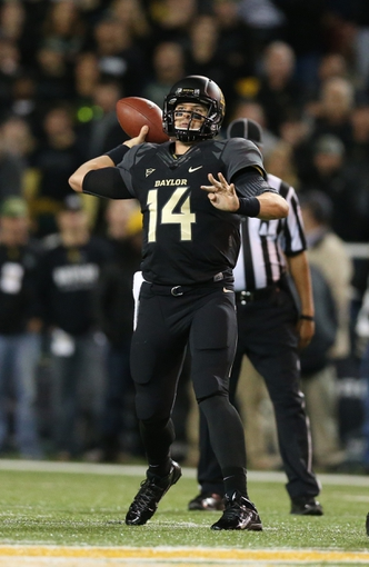 Nov 7, 2013; Waco, TX, USA; Baylor Bears quarterback Bryce Petty (14) throws in the pocket against the Oklahoma Sooners at Floyd Casey Stadium. Mandatory Credit: Matthew Emmons-USA TODAY Sports