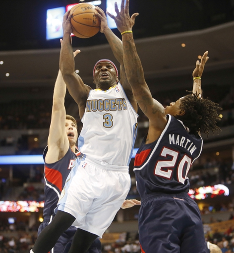 Nov 7, 2013; Denver, CO, USA; Denver Nuggets guard Ty Lawson (3) drives the basket during the first half against the Atlanta Hawks at Pepsi Center. Mandatory Credit: Chris Humphreys-USA TODAY Sports