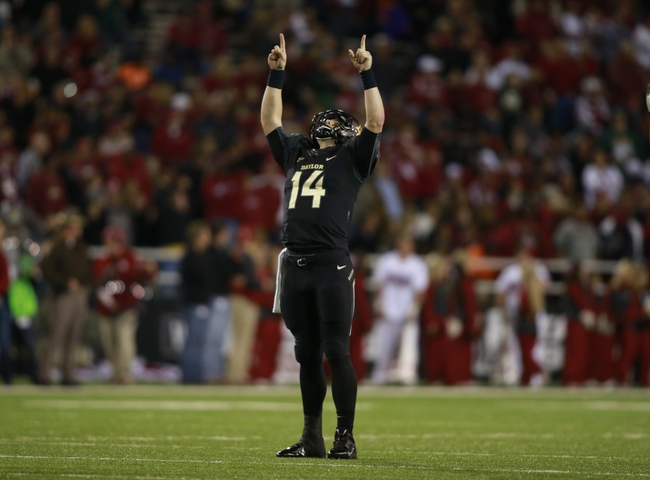 Nov 7, 2013; Waco, TX, USA; Baylor Bears quarterback Bryce Petty (14) celebrates throwing a touchdown pass in the fourth quarter of the game against the Oklahoma Sooners at Floyd Casey Stadium. Baylor beat Oklahoma 41-12.  Mandatory Credit: Tim Heitman-USA TODAY Sports