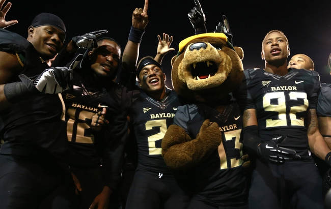 Nov 7, 2013; Waco, TX, USA;  Baylor Bear mascot Bruiser celebrates with the team after the game against the Oklahoma Sooners at Floyd Casey Stadium.Baylor beat Oklahoma 41-12.   Mandatory Credit: Tim Heitman-USA TODAY Sports