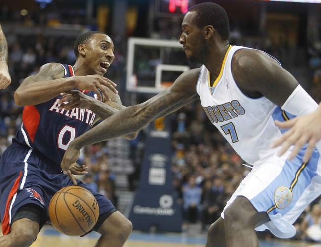 Nov 7, 2013; Denver, CO, USA;  Atlanta Hawks guard Jeff Teague (0) has the ball taken away by Denver Nuggets forward J.J. Hickson (7) during the second half at Pepsi Center. The Nuggets won 109-107. Mandatory Credit: Chris Humphreys-USA TODAY Sports