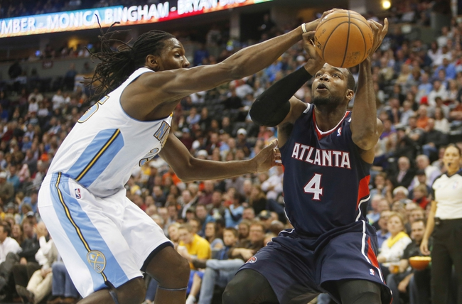 Nov 7, 2013; Denver, CO, USA;  Atlanta Hawks forward Paul Millsap (4) has the ball taken away by Denver Nuggets forward Kenneth Faried (35) during the second half at Pepsi Center. The Nuggets won 109-107. Mandatory Credit: Chris Humphreys-USA TODAY Sports