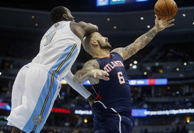 Nov 7, 2013; Denver, CO, USA;  Atlanta Hawks center Pero Antic (6) rebounds the ball in front of Denver Nuggets forward J.J. Hickson (7) during the second half at Pepsi Center. The Nuggets won 109-107. Mandatory Credit: Chris Humphreys-USA TODAY Sports
