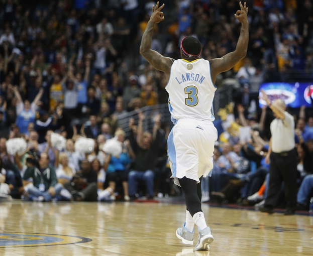 Nov 7, 2013; Denver, CO, USA; Denver Nuggets guard Ty Lawson (3) reacts after making a three point basket during the second half against the Atlanta Hawks at Pepsi Center. The Nuggets won 109-107. Mandatory Credit: Chris Humphreys-USA TODAY Sports