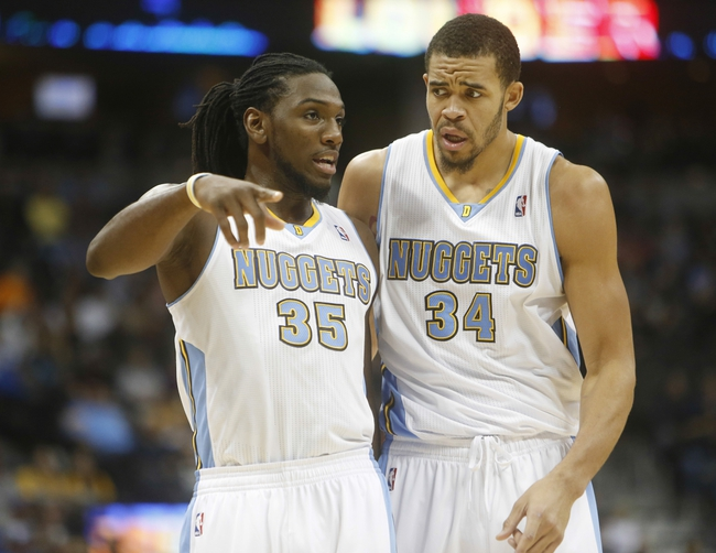 Nov 7, 2013; Denver, CO, USA;  Denver Nuggets forward Kenneth Faried (35) talks with center JaVale McGee (34) during the second half against the Atlanta Hawks at Pepsi Center. The Nuggets won 109-107. Mandatory Credit: Chris Humphreys-USA TODAY Sports