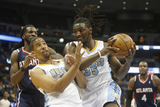 Nov 7, 2013; Denver, CO, USA;  Denver Nuggets forward Kenneth Faried (35) rebounds the ball in front of guard Andre Miller (24) during the second half against the Denver Nuggets at Pepsi Center. The Nuggets won 109-107. Mandatory Credit: Chris Humphreys-USA TODAY Sports