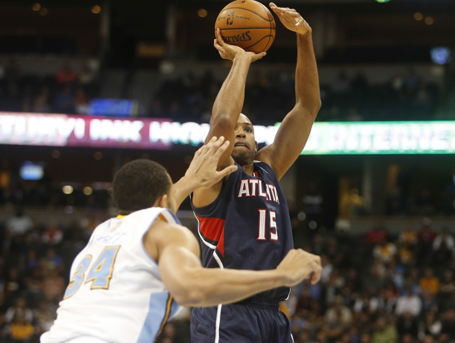 Nov 7, 2013; Denver, CO, USA;  Atlanta Hawks center Al Horford (15) shoots the ball during the second half against the Denver Nuggets at Pepsi Center. The Nuggets won 109-107. Mandatory Credit: Chris Humphreys-USA TODAY Sports