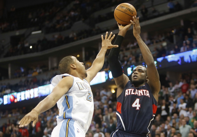 Nov 7, 2013; Denver, CO, USA;  Atlanta Hawks forward Paul Millsap (4) shoots the ball over Denver Nuggets guard Andre Miller (24) during the second half aat Pepsi Center. The Nuggets won 109-107. Mandatory Credit: Chris Humphreys-USA TODAY Sports