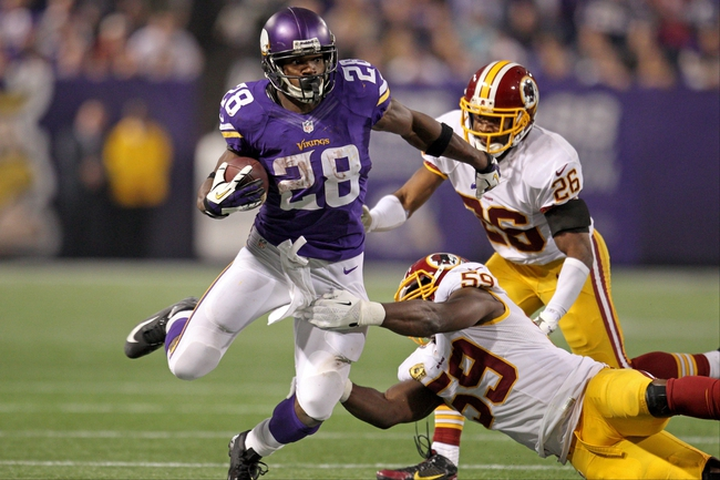 Nov 7, 2013; Minneapolis, MN, USA; Minnesota Vikings running back Adrian Peterson (28) breaks away from Washington Redskins linebacker London Fletcher (59) during the fourth quarter at Mall of America Field at H.H.H. Metrodome. The Vikings defeated the Redskins 34-27. Mandatory Credit: Brace Hemmelgarn-USA TODAY Sports