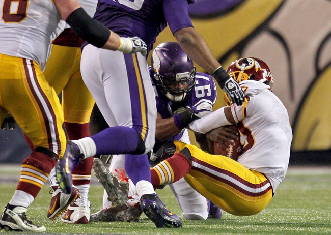 Nov 7, 2013; Minneapolis, MN, USA; Washington Redskins quarterback Robert Griffin III (10) is sacked by Minnesota Vikings defensive end Everson Griffen (97) during the fourth quarter at Mall of America Field at H.H.H. Metrodome. The Vikings defeated the Redskins 34-27. Mandatory Credit: Brace Hemmelgarn-USA TODAY Sports