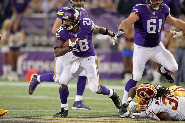 Nov 7, 2013; Minneapolis, MN, USA; Minnesota Vikings running back Adrian Peterson (28) carries the ball during the fourth quarter against the Washington Redskins at Mall of America Field at H.H.H. Metrodome. The Vikings defeated the Redskins 34-27. Mandatory Credit: Brace Hemmelgarn-USA TODAY Sports