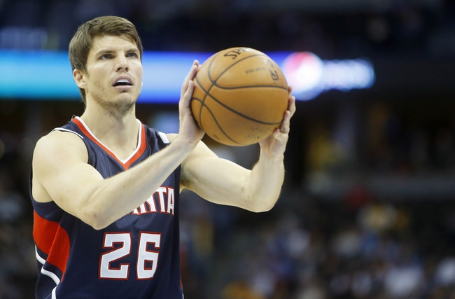 Nov 7, 2013; Denver, CO, USA;  Atlanta Hawks forward Kyle Korver (26) shoots a free throw during the second half against the Denver Nuggets at Pepsi Center. The Nuggets won 109-107. Mandatory Credit: Chris Humphreys-USA TODAY Sports