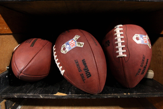 Nov 7, 2013; Minneapolis, MN, USA; Official NFL footballs featuring the Salute To The Troops ribbon during the fourth quarter between the Minnesota Vikings and Washington Redskins at Mall of America Field at H.H.H. Metrodome. The Vikings defeated the Redskins 34-27. Mandatory Credit: Brace Hemmelgarn-USA TODAY Sports