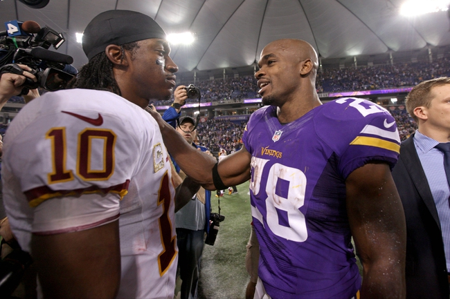Nov 7, 2013; Minneapolis, MN, USA; Washington Redskins quarterback Robert Griffin III (10) talks with Minnesota Vikings running back Adrian Peterson (28) following the game at Mall of America Field at H.H.H. Metrodome. The Vikings defeated the Redskins 34-27. Mandatory Credit: Brace Hemmelgarn-USA TODAY Sports