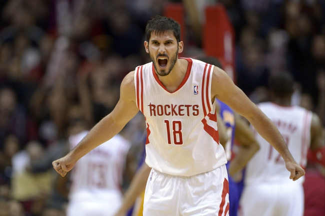 Nov 7, 2013; Houston, TX, USA; Houston Rockets small forward Omri Casspi (18) celebrates a play against the Los Angeles Lakers during the second half at Toyota Center. The Lakers won 99-98. Mandatory Credit: Thomas Campbell-USA TODAY Sports
