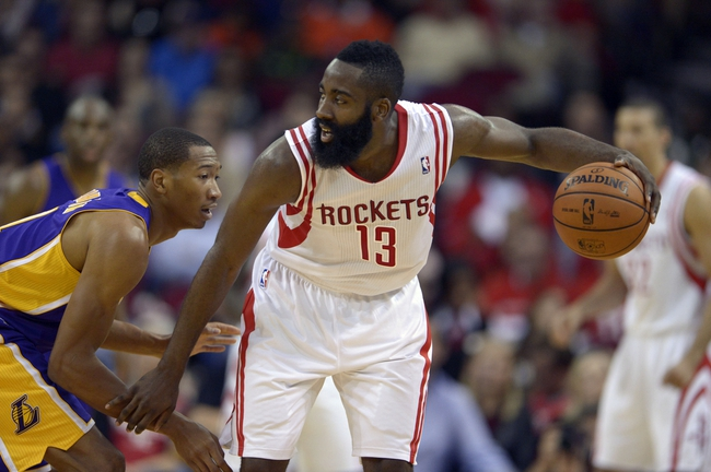 Nov 7, 2013; Houston, TX, USA; Houston Rockets shooting guard James Harden (13) posts up against Los Angeles Lakers shooting guard Wesley Johnson (11) during the second half at Toyota Center. The Lakers won 99-98. Mandatory Credit: Thomas Campbell-USA TODAY Sports